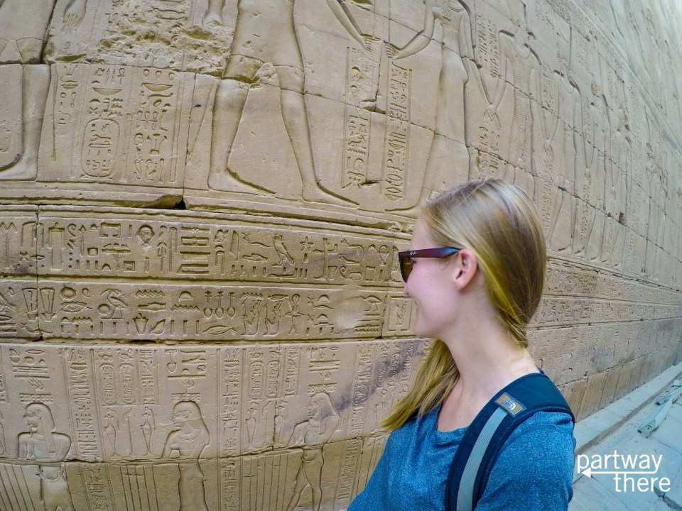 Amanda Plewes looking at hieroglyphs in Kom Ombo