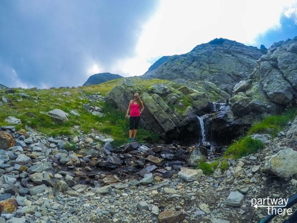 Amanda Plewes at a waterfall at Seven Rila Lakes