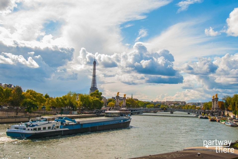 Daytime view of Paris from the Seine with Eiffel Tower and river boat
