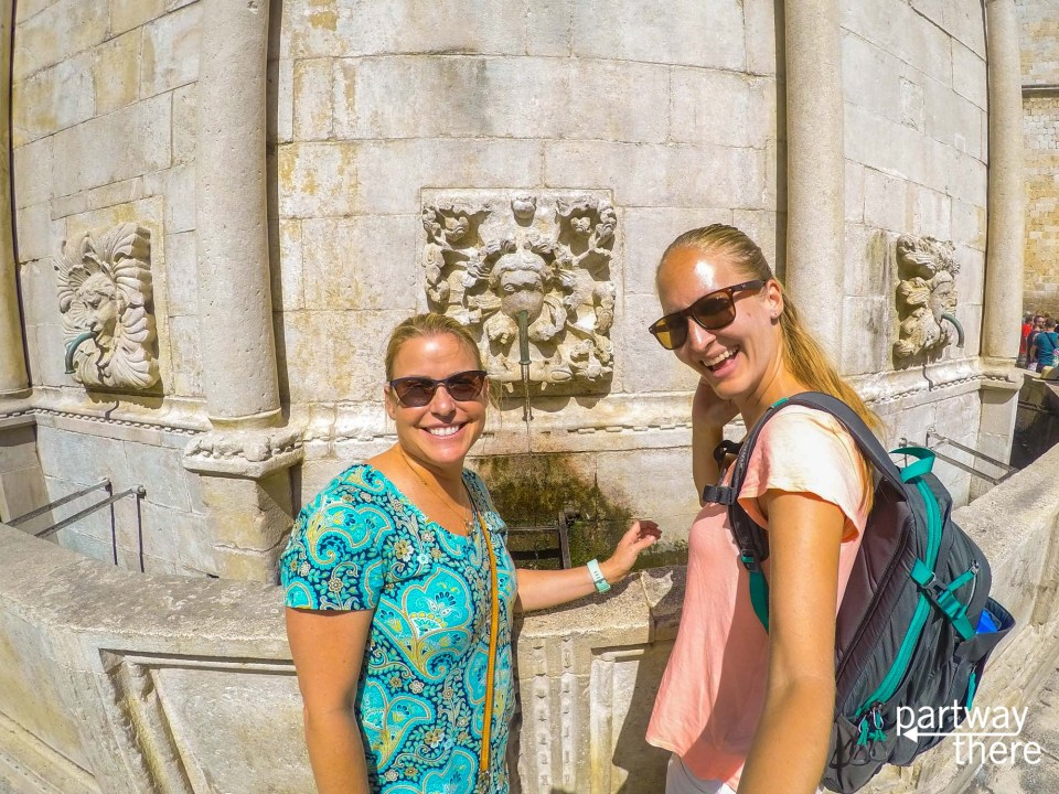 Amanda Plewes and Holly Schiavo at a fountain in Dubrovnik
