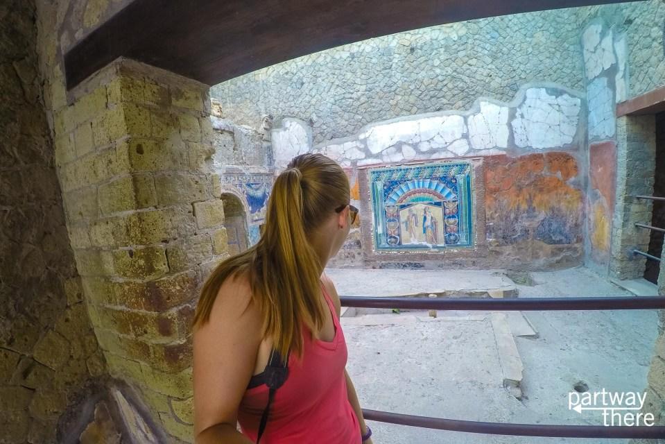 Amanda Plewes looking at a mosaic in Herculaneum, Italy