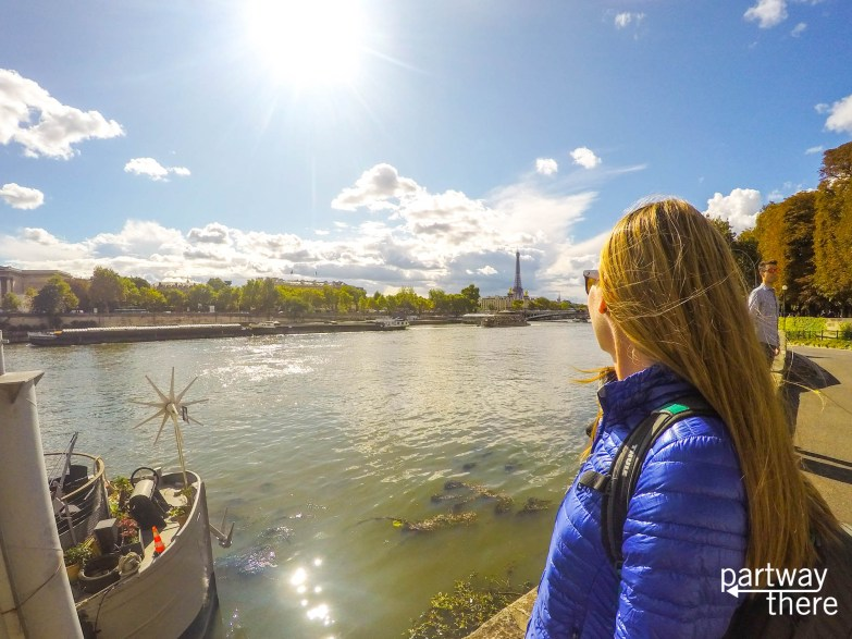 Amanda Plewes looking out at the Seine and Eiffel Tower from the banks of the Seine in Paris, France