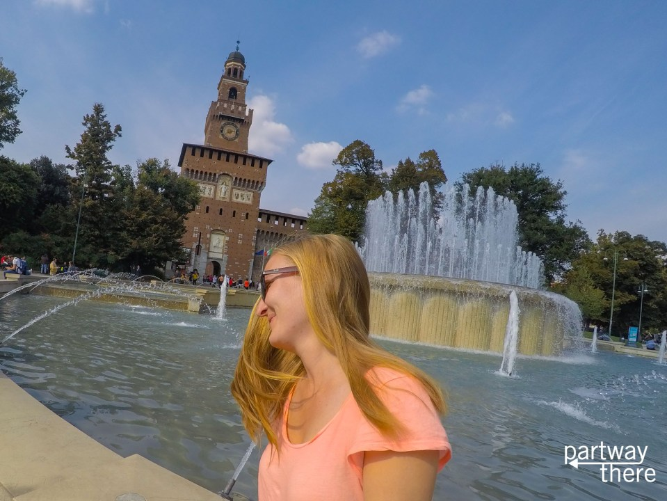 Hair flip in front of Sforza Castle in Milan, Italy