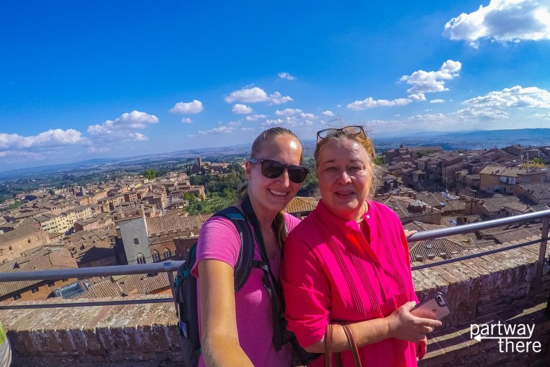 Amanda Plewes and Donna Plewes on top of Siena Cathedral in Siena, Italy with Tuscany in the background