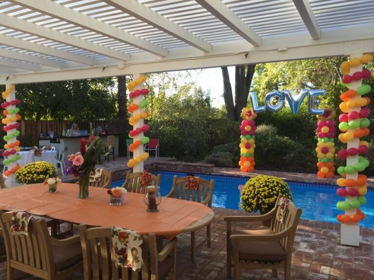 Tropical-themed garland pole wrap & flower patterned columns
