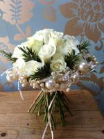 White Roses Paired with Greenery