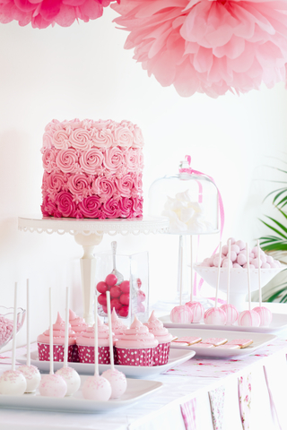 Pink cake and candy buffet