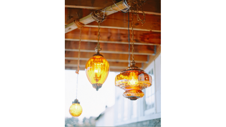 Amber pendant lights you can rent for your boho wedding