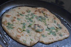 Easy No Yeast Naan Bread - Herb topped Wheatmeal naan bread - Flip to cook the other side
