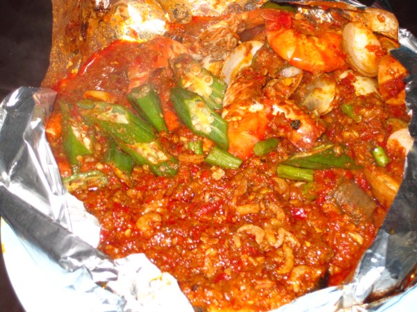 For dinner, a pop-up restaurant in Chinatown offers a foil wrapped SPICY fish medley: prawns, stingray, clams and squid with some okra for good measure.