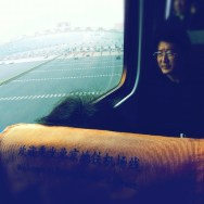 Train flying over a turnpike              by Godo Chillida beijing, china, color, hipstamatic, igersbarcelona, iphoneography, man, passengers, streetphotography, streetphoto_color, train, turnpike, ubiquography,