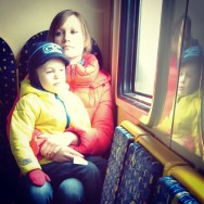 On a small suburban train in a small Baltic state by southcoasting metallicreflection, motherandson, passengers, peopleonpublictransport, redandyellow,