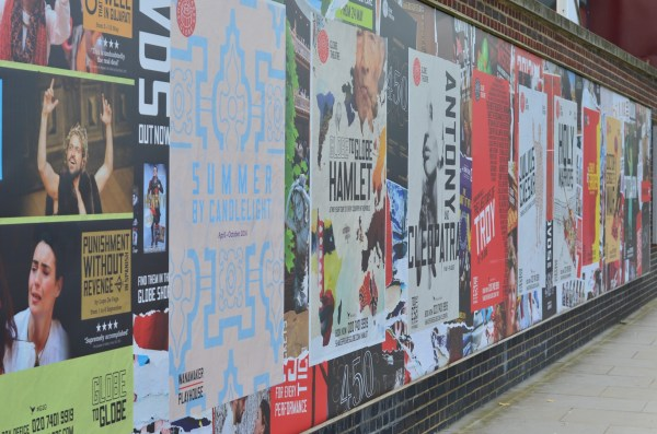 Wall posters in front of the Globe theatre...