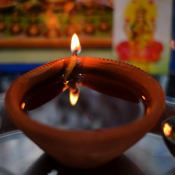 My Diwali 2014 photo-essay. Diwali pooja... and the lamp lighted. #GoddessLakshmi #Ganesha