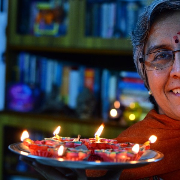 My Diwali 2014 photo-essay. Specky with the diyas...