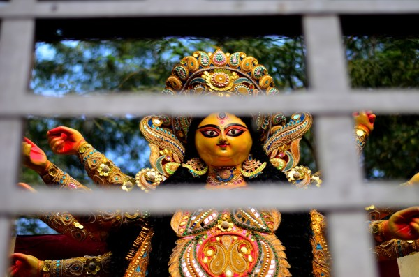015_Durga Puja. Clicked this particular goddess as she looked at me through the bars on the mini truck