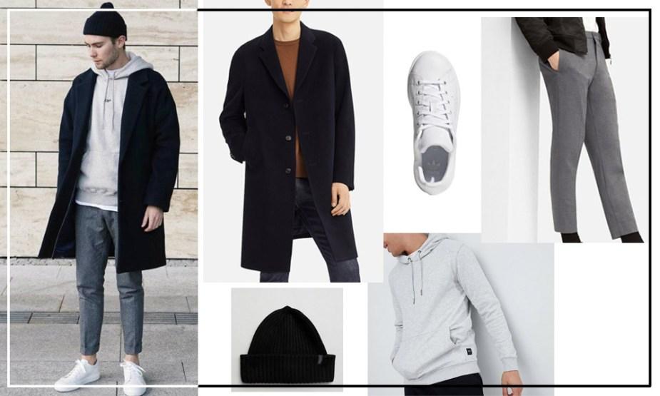 look sportswear chic homme avec un manteau long noir, un hoodie et un pantalon en laine