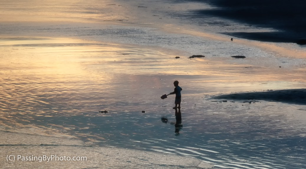 Boy with Shovel at Sunset