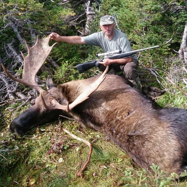 hunter-with-giant-moose-trophy-in-NL