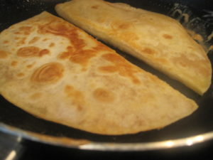 Flip tortillas on to other side and cook two more minutes.