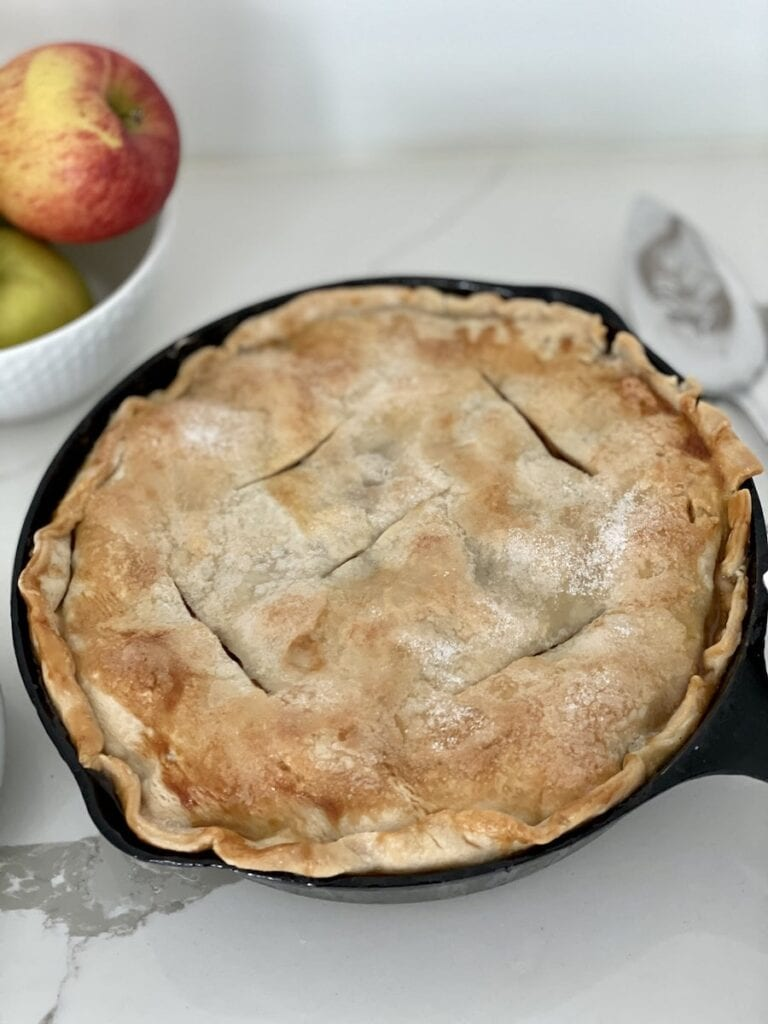 Close Up Apple Skillet Pie in Cast Iron Pan