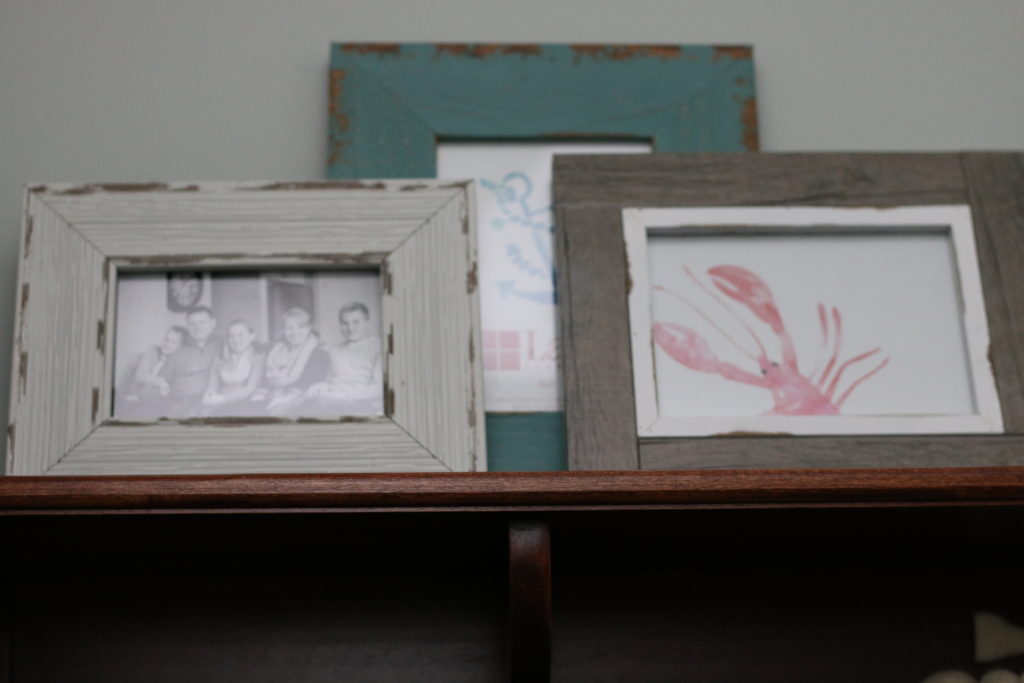 Photos on top of cabinet