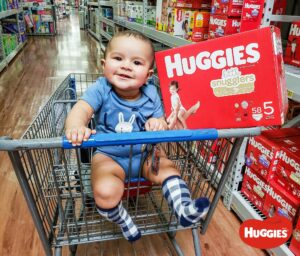 baby in cart with Huggies diapers