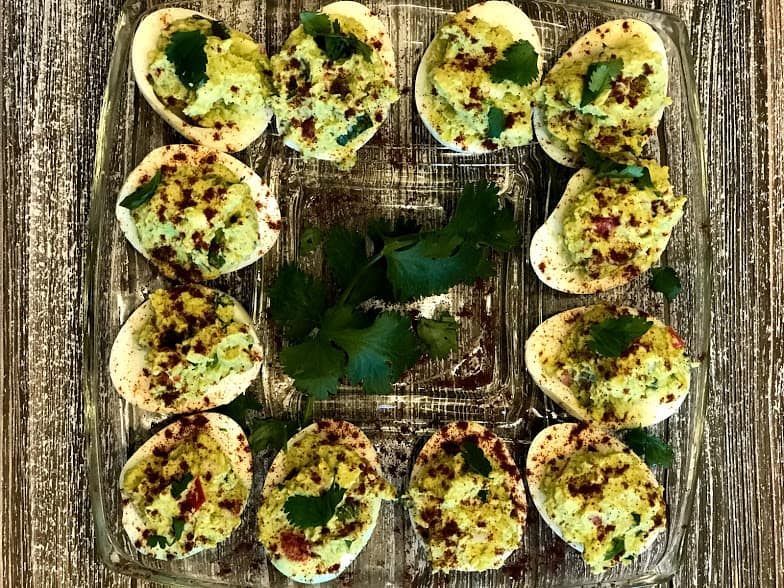 If you're looking for recipes to make with hard boiled eggs, this guacamole deviled eggs recipe is a fun new twist on a classic!