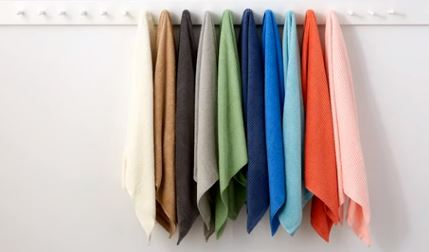 Martha Stewart Towels Hanging on Towel Rack In A Row