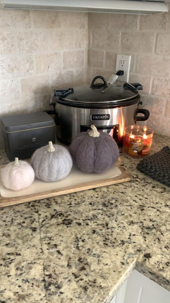 crockpot on counter with fall decorations
