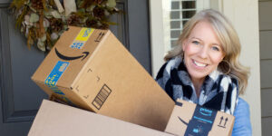 woman holding amazon boxes