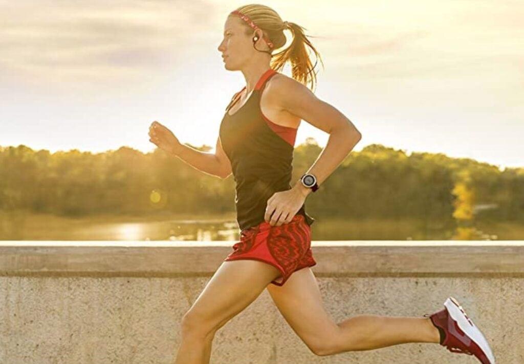 Garmin Watch Sale Woman Wearing a Forerunner watch and running