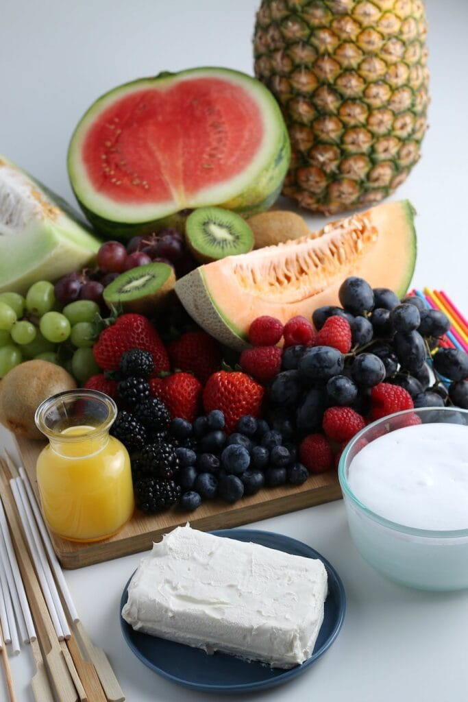 Fruits on a Platter with Ingredients for Fruit Dip