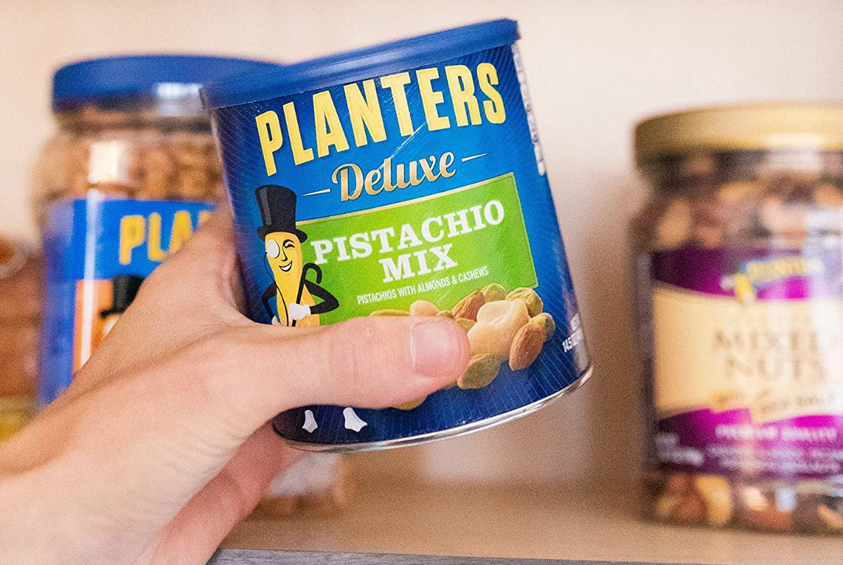 hand holding planters nuts