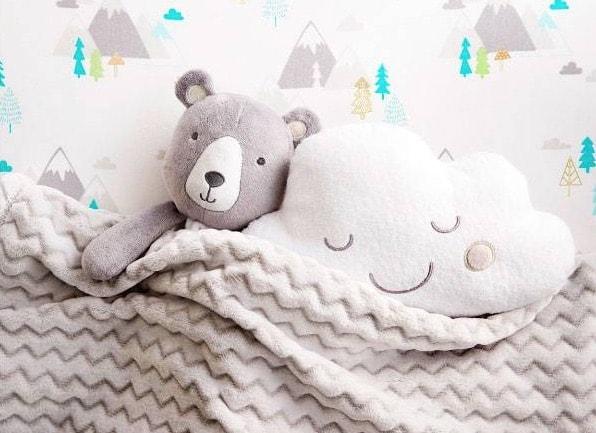 baby blanket and stuffed animals