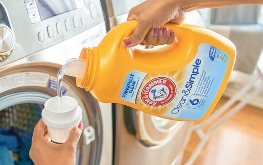 woman pouring laundry detergent