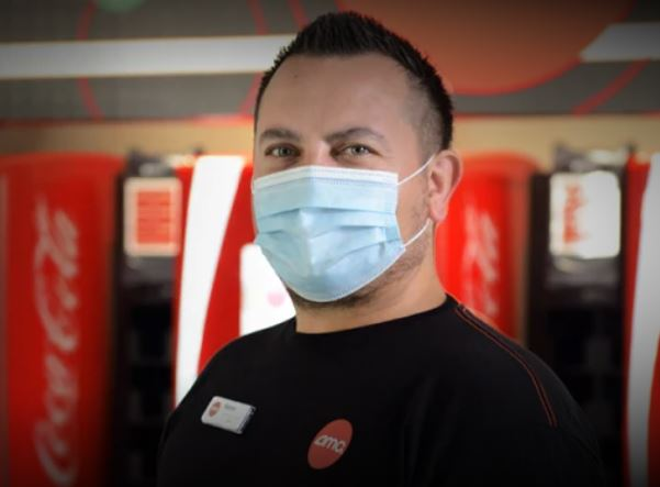 AMC Theatre Deals Safe & Clean Worker with Mask On