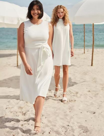 Calvin Klein Dresses 2 woman on beach in white dresses