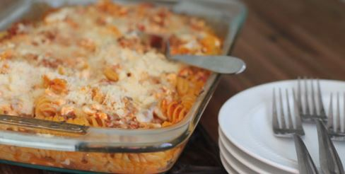 pasta bake with plates and forks