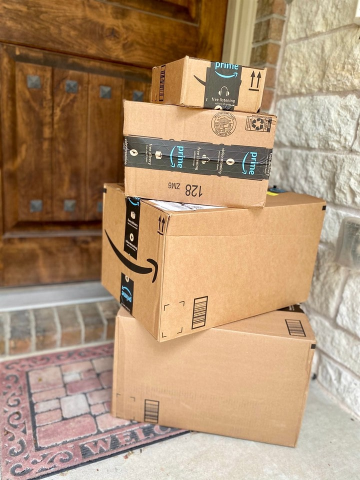 amazon coupon code boxes stacked on porch