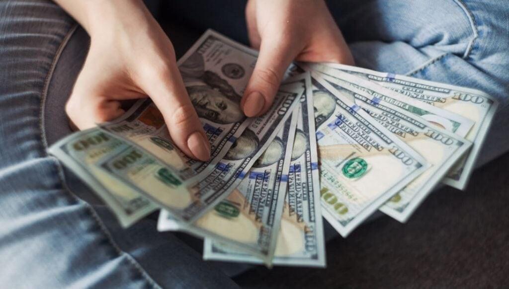 Third Stimulus Check Money in Someones Hands