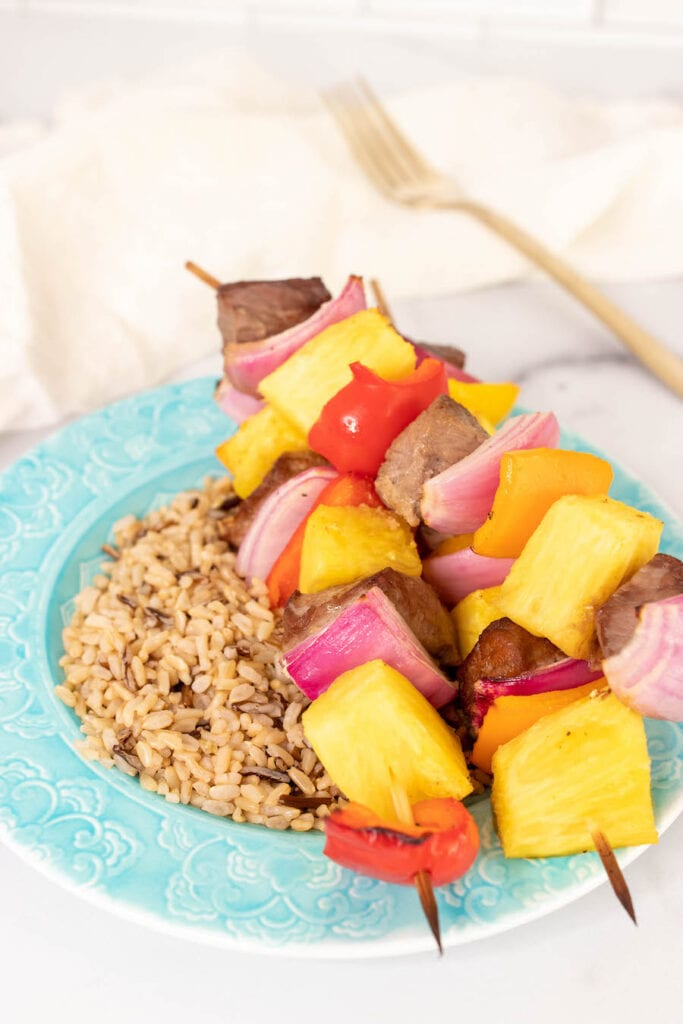 Finished Kabobs Over Rice on Plate