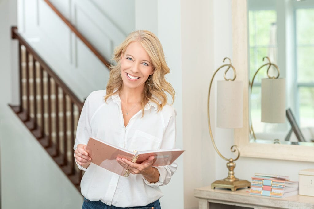 Laurie holding home planner