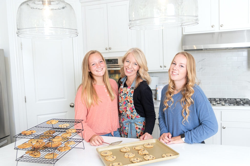 Laurie and girls making chocolate chip cookies