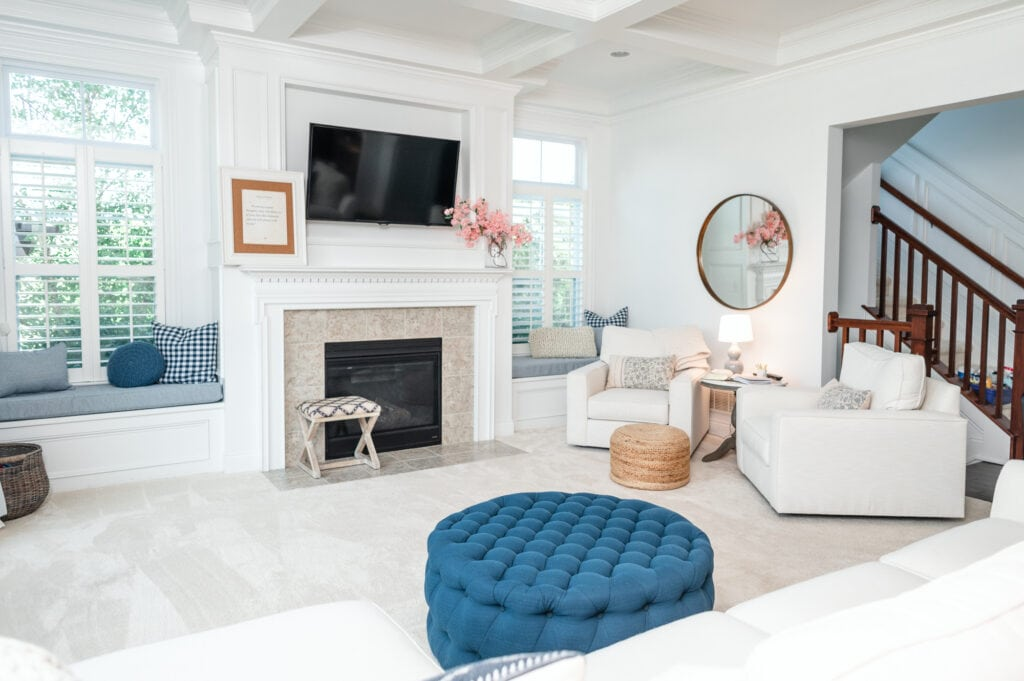 Living room with light furniture and blue ottoman