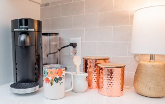 Coffee station with rifle coffee mug and nespresso machine