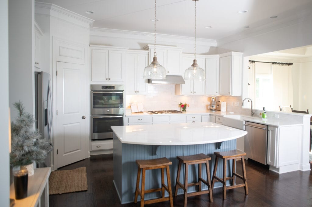 White kitchen with 3 wooden barstools