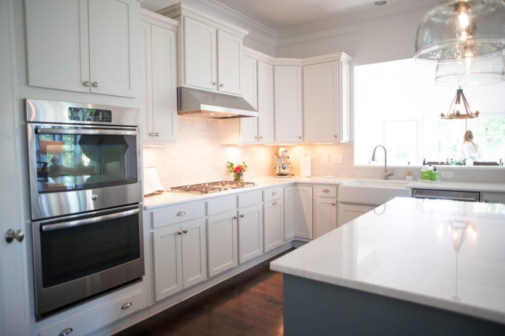 White kitchen with colorful flowers on counter