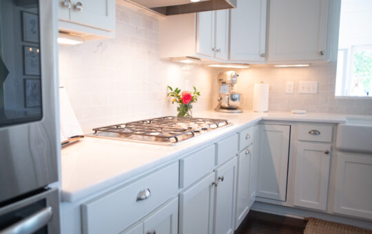 White kitchen with colorful flowers