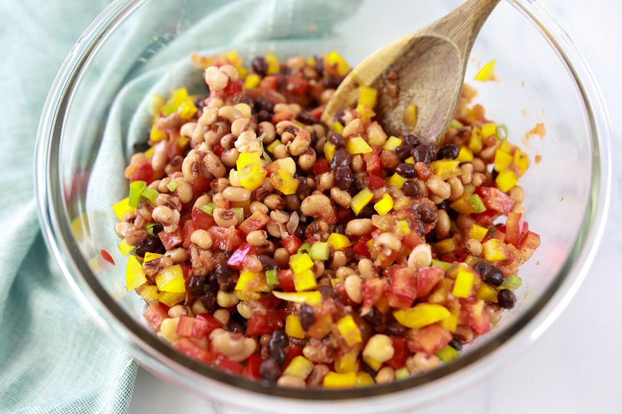 Mixing Beans and Corn in a Glass Bowl